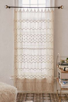 Next idea, since bamboo blinds are out, I think we can find a clever way to hang this...