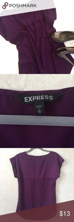 Express Top in Plum/ Purple Size M Pre-owned and worn in good condition.  Cute plum color in size M.  Very slight discoloration in armpit area.  Even from the pics you can barely tell. Express Tops Blouses