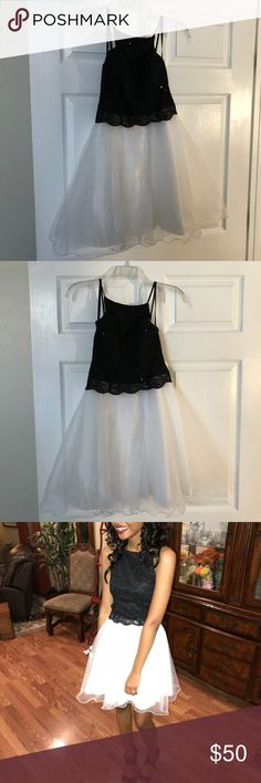 Black & white formal dress Only worn once. Was altered to fit a size 0-2. Has lace material at the top Dresses Prom