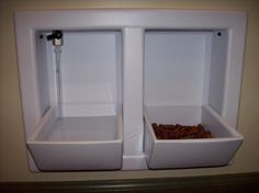 Dog food/water bowls built into the wall (WITH water faucet!) (Designer Pet Eatery).