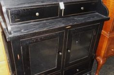Nice little black cabinet. Many uses for this cabinet. Make it a bar, a sideboard, a buffet, a display cabinet, a hutch for kitchenware. Very unique piece.  Item # 1569-705