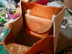 Working on new leather shopping bag. The small compartment is removable.