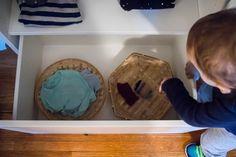 A DIY Montessori toddler wardrobe made with IKEA BESTA shelving