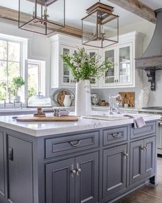 Country Kitchen with Dark Center Island-double lantern pendants-honed marble countertops-white glass cabinets-french range hood Country Kitchen Designs, French Country Kitchens, Rustic Kitchen Design, Modern Farmhouse Kitchens, Home Decor Kitchen, Home Kitchens, Kitchen Ideas, Farmhouse Style, Country Kitchens With Islands
