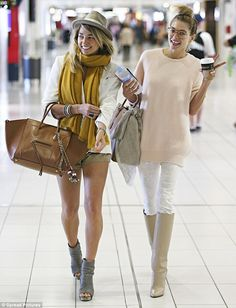 Sister act: Ashley Hart (L) and Victoria's Secret Angel Jessica Hart (R) make their way across Sydney Airport on Wednesday