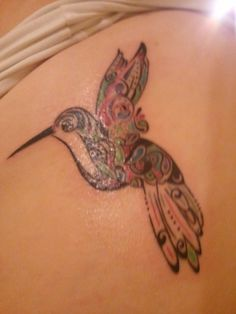 my aunt's paisley humming bird tattoo <3