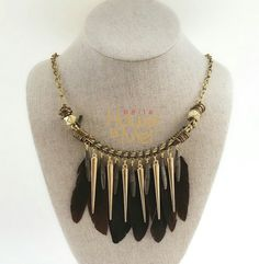 Bohemian inspired feather collar necklace available at bella House Of Mel.  #womensfashion #boho #tribal  #statement #jewelry #gift #giftguide
