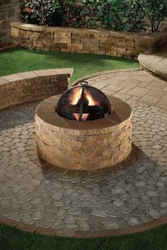 A brick paver patio and a fire pit make up this outdoor living design.