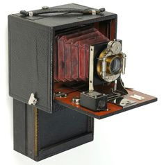 "Antique Camera: A very obscure c.1899 pre-patent model of the 4"" x 5"" Chase Folding Magazine Camera. The plate changing mechanics was supposed to make this as easy to use as roll film ... not really in reality!"