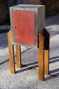 This is an old metal cabinet who got a paint job and four hardwood legs courtesy of a decommisioned church pew. Now he looks like a rocket/robot. Art Furniture, Robot, Hardwood, Legs, Metal, Table, Painting, Home Decor, Natural Wood