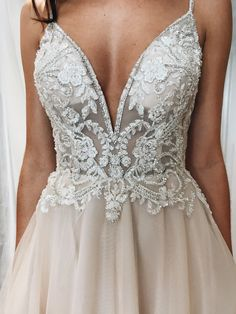 Spaghetti strap plunging v-neck lace and illusion wedding dress from David's Bridal #weddingdress