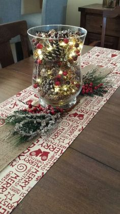 Rustic Christmas centerpiece with pinecones and LED string lights.                                                                                                                                                                                 More