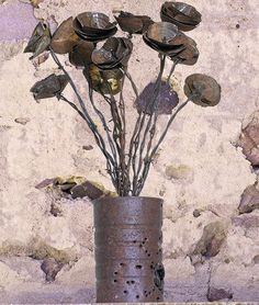 rusty old tin can & barb wire flowers