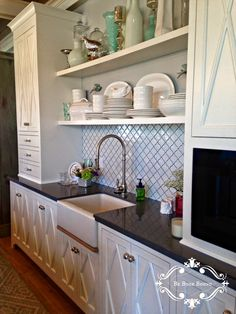 Like the kitchen cabinets with the shelves between.  Like the styling with mint green and white kitchen decor. Love the backsplash.
