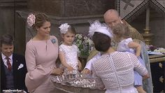 A cute moment where Crown Princess Victoria helps Princess Leonore while Princess Madeline helps Princess Estelle during Prince Oscars christening.