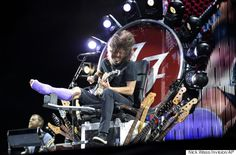 Dave Grohl broke his leg a few weeks ago and had to cancel the remainder of the Foo Fighters European tour. But on July 4th, he played from a throne made of guitars and lights - The Show Must Go On!!  ROCK AND ROLL!!!!!