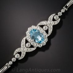 Edwardian Aquamarine and Diamond Bracelet.  This truly rare (aquamarine bracelets from the period are few and far between) and ravishing Belle Époque jewel, masterfully handcrafted in platinum, circa 1910-1920, glistens front and center with an enchanting sky blue oval aqua, set within a glittering halo of bright white old mine-cut diamonds...