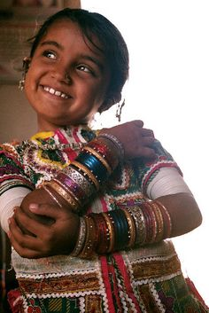 Happy Girl , India  In India, jewelry indicates that you are loved by your parents as a young girl.