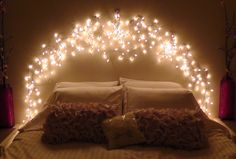 How-To Icicle Light Faux Headboard-the lights and command hooks- cheap and easy-my favorite!