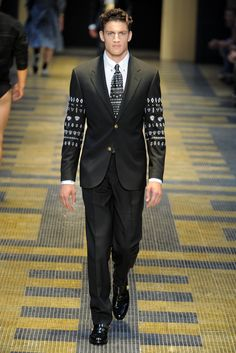 Versace Men's RTW Spring 2013? This collection is mostly impractical outside of any large fashion capital but it's genuine brand correct story was captivating. Most of what I have seen has been just a redux of what has come before, except this. Applause.