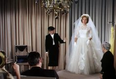 Edith Head  in her cart | Debbie Reynolds(Jessica) is fitted for her wedding gown, Edith Head in ...
