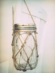 fish net jars for back of chairs at ceremony