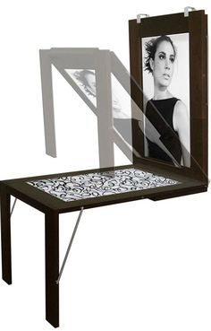 Fold-down wall mounted table turns into a picture - Fold-down wall mounted table turns into a picture frame. Ikea should do one for kids so they can do art on the table and then slip their creations right into the frame. [only]1,440 Euros  Repinly Ho