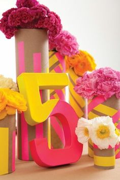 Use maroon and gold! - Tone down the flowers - Paint cardboard tubes with neon stripes (or use bright tape) to make vases