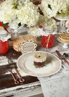 Loving these vintage country place settings in the Mershon Events Tabletop complete with mini jam favors, mason jars with punch, and lace linens from Party Perfect Linens. Photo by Jesse Reich Photography. #wedding #placesetting #vintage #country #rustic #favor #jam #masonjar