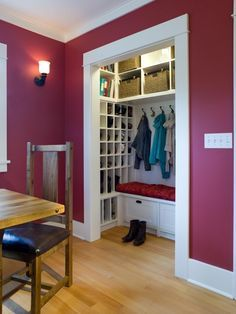 A custom-designed storage solution keeps coats and shoes handy and organized off the breakfast area in this Craftsman home.