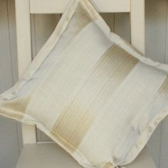 http://www.willowanddixon.com/collections/cushions/products/stunning-cushions-in-champagne-gold-and-cream