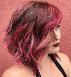 Was just scrollin' and my girl @marissarmiller caught my eye I figure another pic/angle of this lush Red Velvet and textured lob was in order I foiled highlights w/ @brazilianbondbuilder then overlaid with 5VR, City Beats Chelsea Coral and a Shades Pastel Pink/Peach custom shade. Styled using @sexyhair Powder Play Lite to boost the root and Rose Dry Oil Spray for shine. I use a lot of different lines (and will continue to) because I like variety! Let's keep it real...having options is a...