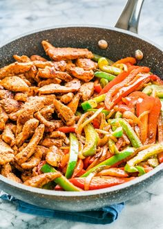 These easy chicken fajitas will become your favorite weeknight chicken fajitas! Just like the restaurant version but homemade and ready in 30 minutes.