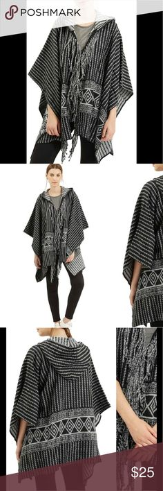 Topshop Black & White Fringe Poncho A playfully fringed front and striking black-and-white geo print bring Western flair to this knit hooded poncho cut for a comfy, free-flowing fit. Topshop Sweaters Shrugs & Ponchos
