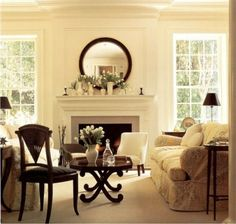 flank the fireplace with ceiling to floor multi-paned windows or glass- paned doors to let in the light.