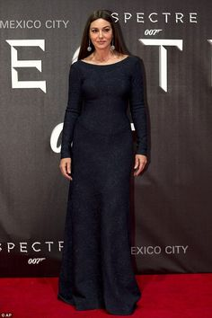 Evergreen: Monica Bellucci, 51, wore a shimmering navy long-sleeved gown for the occasion...