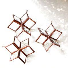 Glass Bevel Stars, Stained Glass Geometric Stars Suncatchers, 3D Bevel Stars. $35.00, via Etsy.