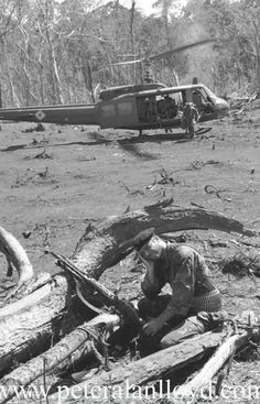 Another chopper lands in a huge area cleared by a BLU-82 Daisy Cutter bomb during the Vietnam War.