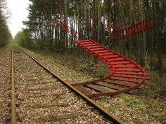 'Sidetrack' (2010) by Dutch artist Karin van der Molen. Site-specific installation of wood & paint in Bippen, Germany. via eARTh