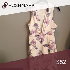 Dress White/ivory color with pastel water color flowers in purple and pink. Never worn!! Tobi Dresses Mini