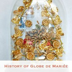 The tradition of Globe de Mariée Display pieces began in France, in the 1800's. It was a display for married couples, to preserve their wedding souvenirs as well as tell the story of their we…