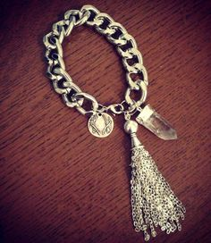 Chunky silver curb chain bracelet with raw quartz crystal point and large chain tassel features. Lead