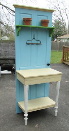 Tim made this blue potting bench from an old door