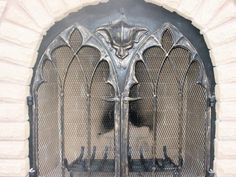 gothic cathedral style fireplace doors