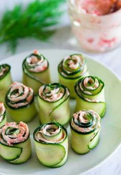The best smoked salmon cucumber appetizers. Thinly sliced cucumber rolled up with smoked salmon cream cheese spread inside. and Drink activities for kids Smoked Salmon Cucumber Rolls Cucumber Appetizers, Cucumber Recipes, Yummy Appetizers, Appetizers For Party, Appetizer Recipes, Easter Appetizers, Vegetable Appetizers, Seafood Appetizers, Simple Appetizers