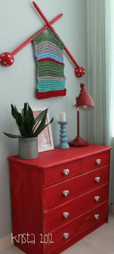Knitted Wall Art @Susan Caron Caron Lingelbach !!! I love this idea.  I could do this with the old handmade wooden knitting needles from grandma's house!
