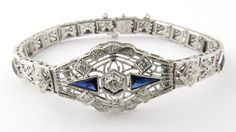 Vintage 14k White Gold Diamond and Sapphire Filigree Bracelet The diamonds and sapphires in this bracelet sparkle and dazzle the eye of the beholder.