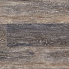 There's a rustic, casual elegance to the intriguing blend of light and dark hues that is enhanced by the on trend weathered oak effect in this luxury vinyl plank flooring.