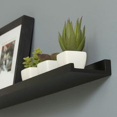 Photo ledge from Smart Furniture:  Maybe in white but to display books in the kid's room.