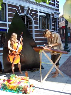 http://WhoLovesYou.ME | The streets of Asheville are filled with street music and other buskers. This duo is always worth slowing down to watch. #streetperformer #busker